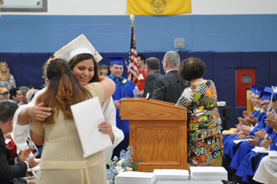 Students receive diplomas